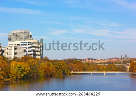 Autumn panorama of metropolitan Washington DC, USA. Modern and historic buildings and bridges across Potomac River with trees in a multicolor fall foliage. - stock photo