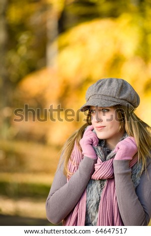 Autumn park - fashion model woman wear cap on sunny day