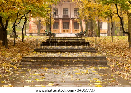 Autumn park with a footpath to a building. The Lvov park - stock photo