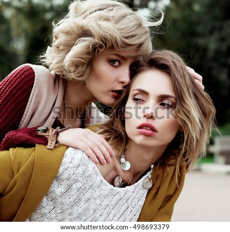 stock photo autumn photo of a two beautiful women in the park 498693379