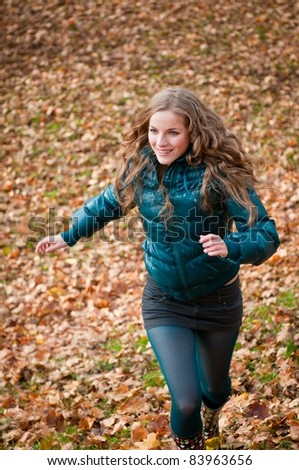 Autumn pleasure - young woman running