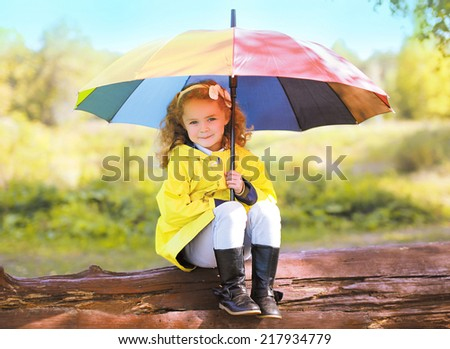 Autumn portrait  little child with colorful umbrella outdoors - stock photo