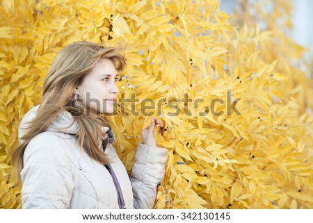 Autumn portrait of a beautiful young woman - stock photo
