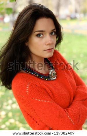Autumn portrait of a girl in a red sweater - stock photo