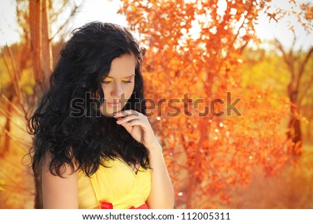 Autumn portrait of beautiful brunette woman model with bright makeup - stock photo