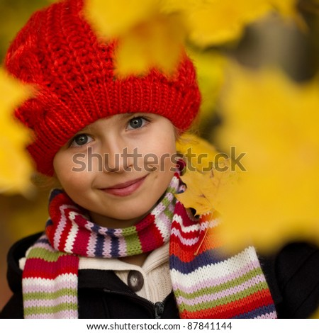 Autumn - Portrait of beautiful girl in autumn park - stock photo