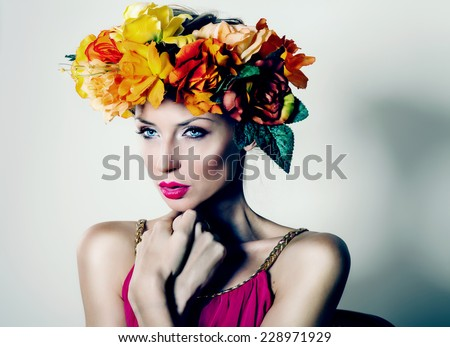 Autumn portrait of blonde beautiful woman with flowers on head. Romantic girl