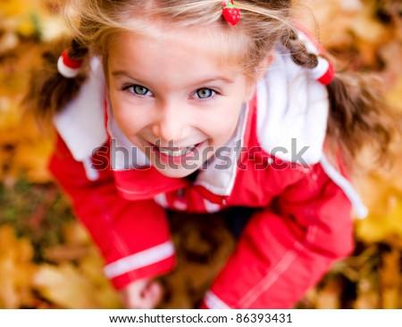 Autumn portrait of cute little caucasian girl