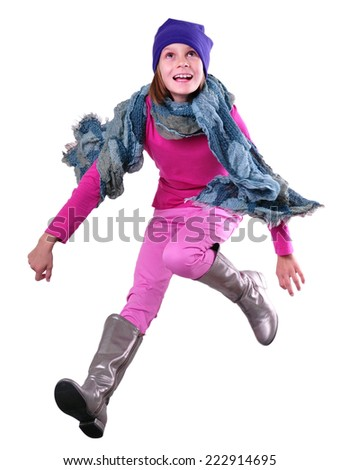 autumn portrait of happy active child with hat, scarf and boots jumping running having fun. Isolated over white - stock photo