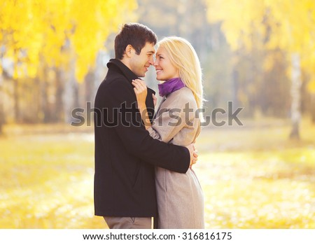 Autumn portrait of happy loving young couple in love outdoors