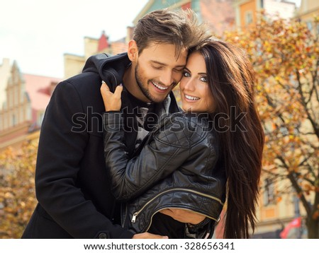 Autumn portrait of hugging couple - stock photo