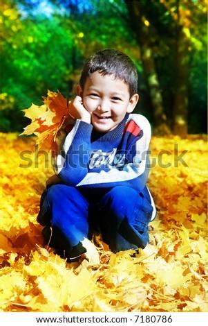 Autumn portrait of the boy - stock photo