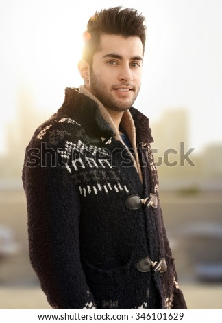 Autumn portrait of young man in cardigan. - stock photo