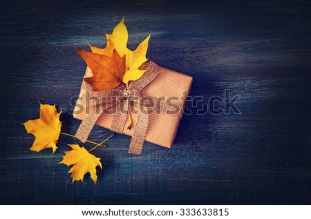 Autumn presents with yellow leaves - stock photo