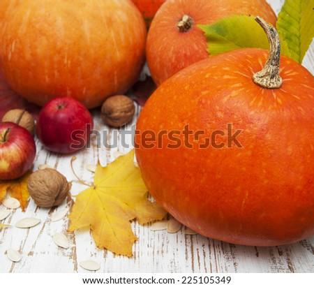 Autumn pumpkin composition on a wooden table - stock photo