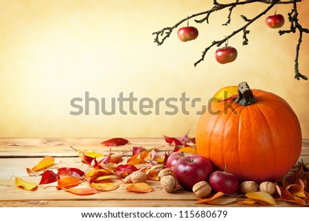 Autumn pumpkin composition on wooden table with copy space - stock photo