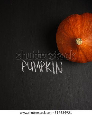 autumn pumpkins on black background with its name