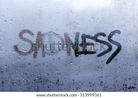 Autumn rain, the inscription on the sweaty glass - sad, sadness