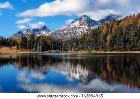 Autumn reflections on the lake Silvaplana, Engadine Saint Moritz, Switzerland