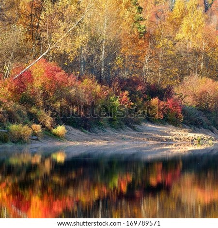 Autumn river Gauja in Sigulda, Latvia. Landscape with reflection - stock photo