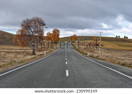 Autumn Road. Christchurch to Tekapo Road, Canterbury, New Zealand - stock photo