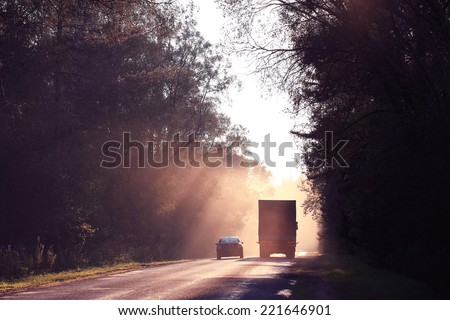 Autumn road sunset, the rays of light, the journey - stock photo