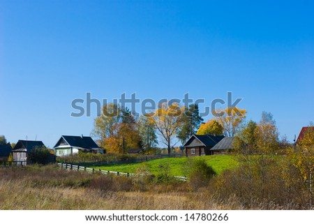 Autumn rural scene with country houses