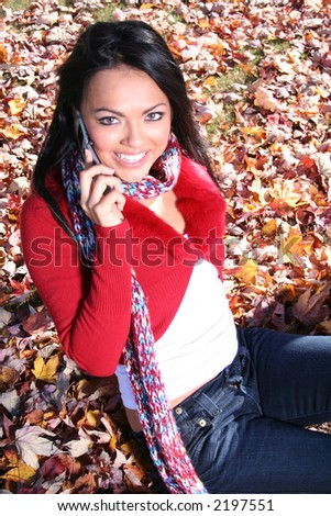 Autumn Scene Fall Woman With Cell Phone Communications Scene With Eye Appealing Model - stock photo