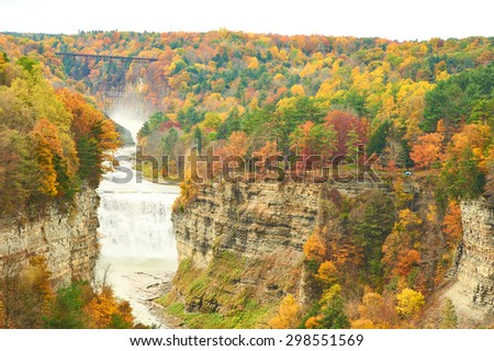 Autumn scene landscape of waterfalls and gorge at Letchworth State Park - stock photo