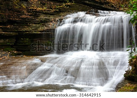 Autumn scene landscape of waterfalls at Buttermilk Falls State Park - stock photo