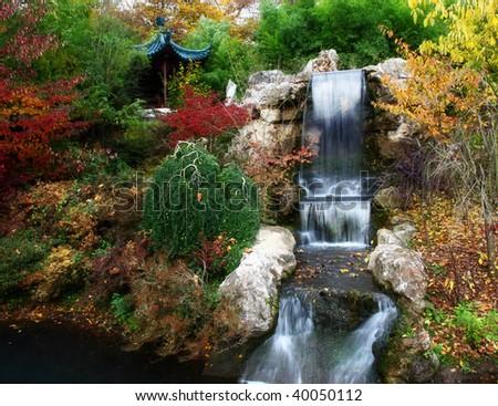 Autumn scene , oriental and waterfall - stock photo