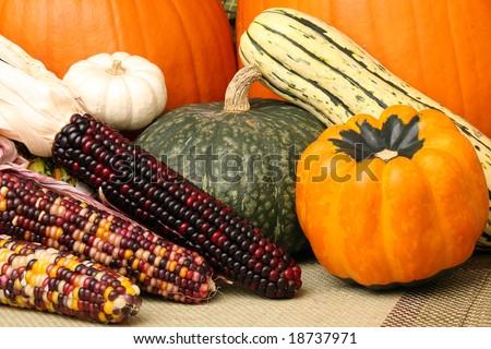 Autumn scene with pumpkins, corn, and colorful orange and green squash - stock photo