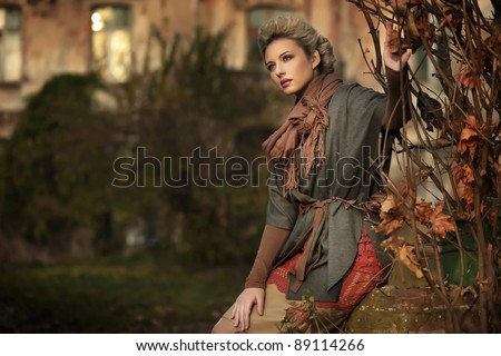 Autumn scenery and blond beauty - stock photo