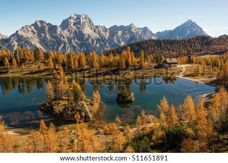 Autumn scenery at lake Federa in Dolomites mountains in Italy.