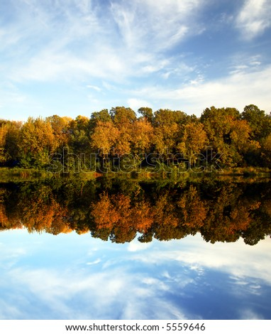 Autumn scenery - colorful trees reflection - stock photo