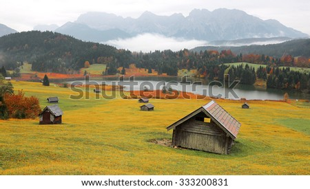 Autumn scenery of Lake Geroldsee with Karwendel mountains in the background, an alpine lake between Garmisch-Partenkirchen and Mittenwald, in Gerold, Bavaria, Germany - stock photo