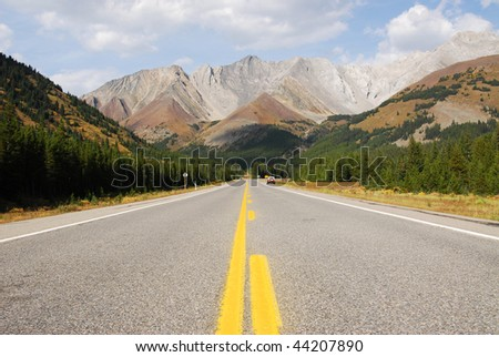Autumn scenic view of rocky mountains and highway 40 while traveling in kananaskis country, alberta, canada - stock photo