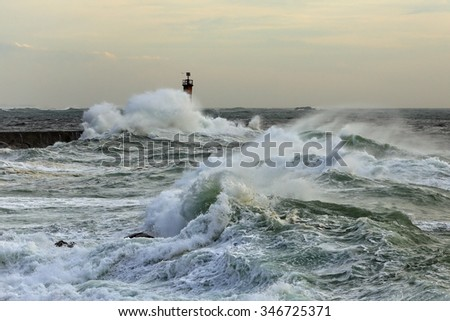 Autumn sea storm at the mouth of the Ave river, north of Portugal - stock photo