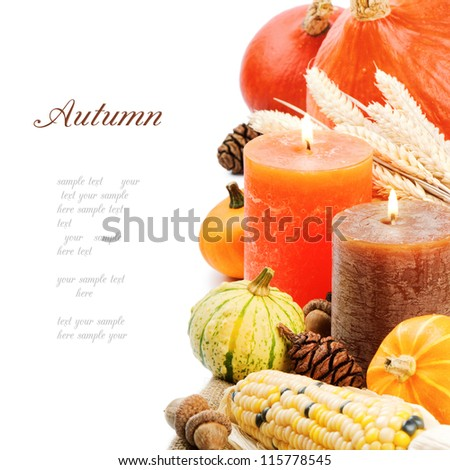 Autumn setting with candles and pumpkins isolated on white - stock photo