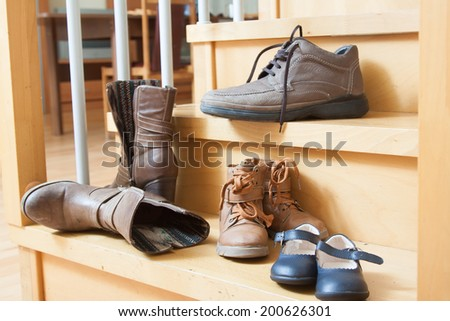 Autumn shoes  on  stairs in  house - stock photo