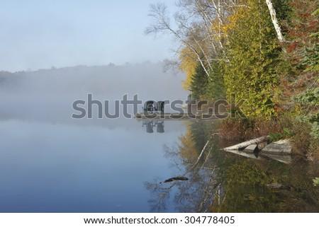 Autumn Shoreline and Dock on a Misty Morning in the Haliburton Highlands - Ontario, Canada - stock photo