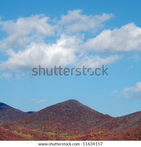 Autumn Smoky Mountains with blue sky and clouds - stock photo