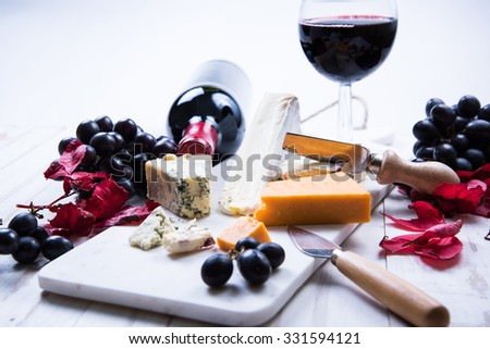 autumn snack selection with cheese and wine, overhead - stock photo