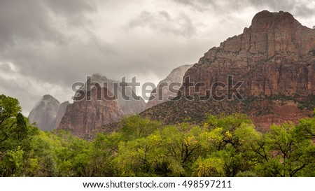 Autumn squall over Mountain of the Sun, Twin Brothers and East Temple peaks, in Zion National Park, near Springdale, Utah.