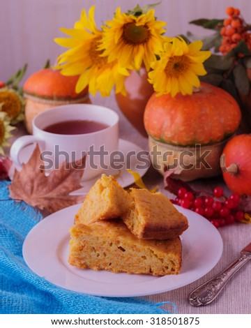 Autumn still life. Homemade Pumpkin Pie and tea for Thanksgiving Day. Selective focus.