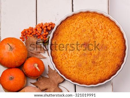 Autumn still life. Homemade Pumpkin Pie for Thanksgiving Day. Selective focus. - stock photo