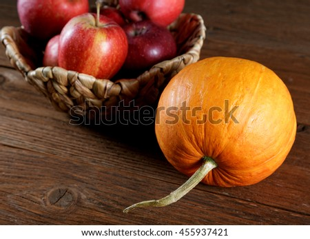 Autumn still life with apples and pumpkins - stock photo