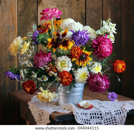 Autumn still life with flowers: asters, chrysanthemums, camomiles. - stock photo