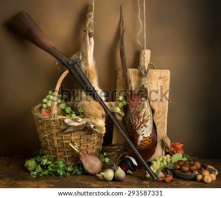 Autumn still life with hunting rifle, pheasant and hare - stock photo