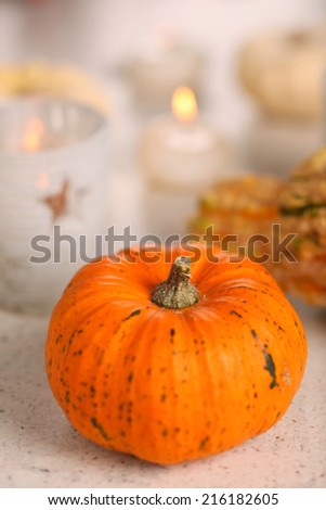 Autumn still-life with pumpkins and candle. - stock photo